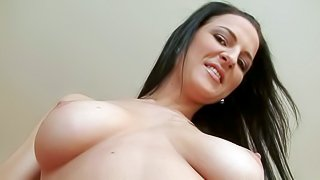 Juicy brunette Walleria with big natural tits and puffy pussy bares all and shows her private parts to Rocco Siffredi. She touches her snatch before she strokes his dick with her feet from your point of view