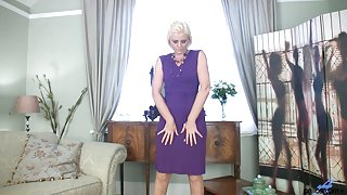 Blond MILF Rebecca masturbates in stockings