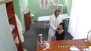 Doctor fucks beautiful busty patient in an office
