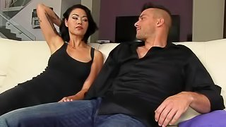 Black haired asian MILF Dana Vespoli with perfect bubble butt is in the mood for anal sex. She gets her asshole licked and drilled by a hard cock on the couch in the living room