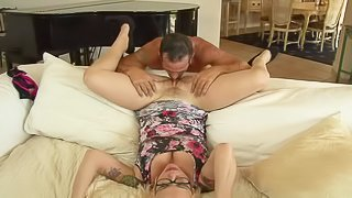 Big breasted blonde MILF with glasses Missy Monroe spreads her legs on the couch by the fire and then gets her hot pussy licked and fucked by Rusty nails. He loves her twat