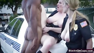 Lovely blonde cop crushing big black cock on her hungry mouth